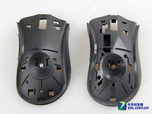 炼狱蝰蛇2013版(左)与炼狱蝰蛇鼠标(右)上壳对比 拨开雷蛇炼狱蝰蛇2013版游戏鼠标按键板与上壳连接的四个卡扣,即可将按键板与鼠标上壳分离。由于内部结构的改变,雷蛇炼狱蝰蛇2013版游戏鼠标上壳上取消了用于防止侧键微动位移的固定装置,改由其它方式解决这一问题。通过对比可以看到,雷蛇炼狱蝰蛇2013版游戏鼠标为保证上壳整体强度,在上壳与按键板结合面设计有多条加强筋来,这一点与炼狱蝰蛇鼠标基本相同。